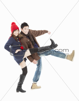 Young happy  couple in winter clothing and isolated on white