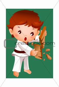 Boy breaking a board using karate