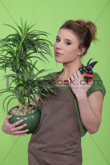 young woman holding a flowerpot
