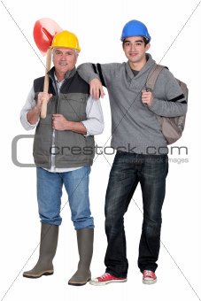 Builder with young apprentice