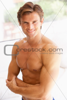 Portrait Of Bare Muscular Torso Of Young Man