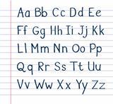 Handwritten alphabet on lined paper