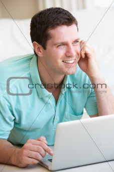 Young man on his laptop computer
