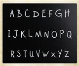 Text handwritten with white chalk on a blackboard