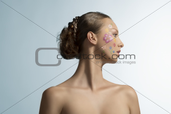pretty girl with floral make-up, turned in profile