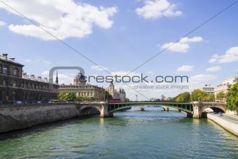 View of Palais de Justice and a bridge over the Seine river. Par