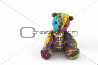 Handicraft colorful  bear on a white background