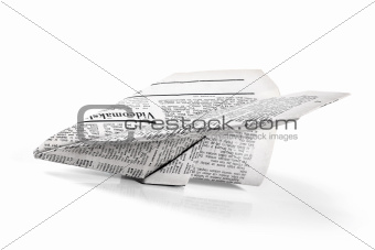 paper plane from newspaper isolated on white