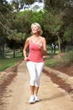 Senior woman running in park