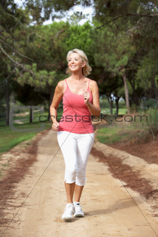 Senior woman running in park