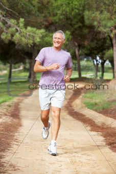 Senior man running in park