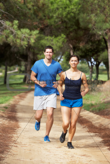 Couple running in park