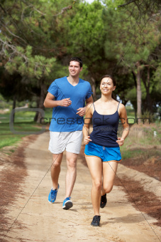Young couple running in park