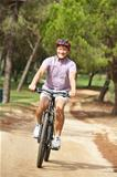 Senior man enjoying bike ride in park