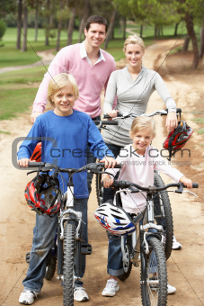 Family enjoying bike ride in park
