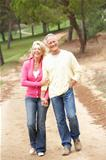 Senior Couple enjoying walk in park