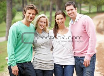 Group of friends enjoying walk in park