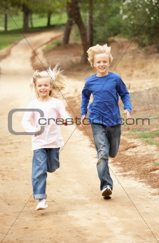 Two Children running in park