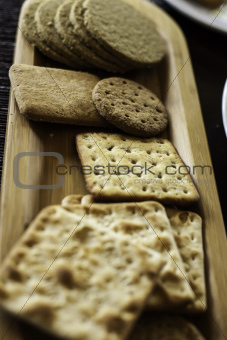 Various biscuits on a wooden plate