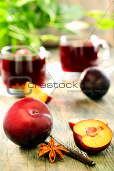 Plums, spices and cups compote.