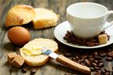 Coffee beans, eggs, bread and butter.