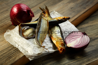 Smoked sprat and red onion.