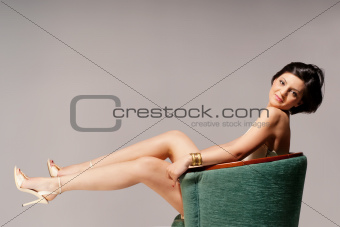 Green chair and a model