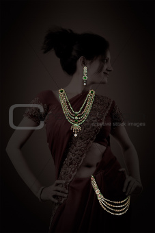 Indian woman posing with jewelry