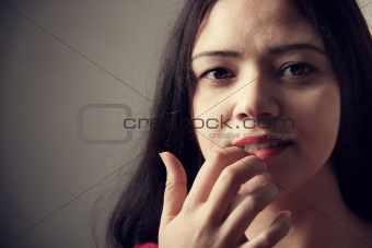 Pretty Indian woman portrait, finger on lips