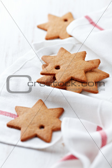 Gingerbread stars on a kitchen towel
