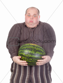 Fat man struggling to hold the weight of a whole watermelon