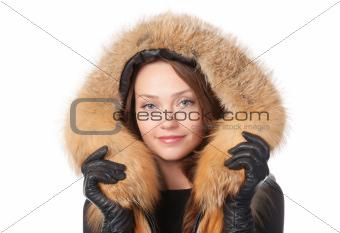 Beautiful woman in fur trimmed jacket