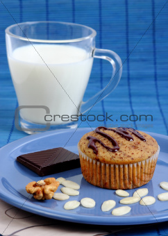 Muffin cake, milk and chocolate