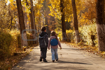 Kids walking in early autumn
