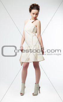 Beautiful fashion model girl in white dress posing