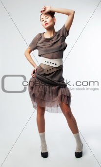 Young beautiful asian female posing in studio