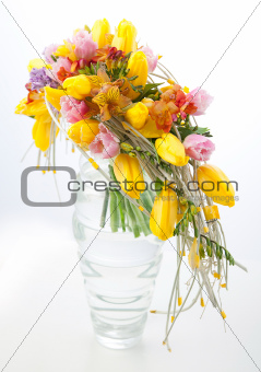 Colorful flowers bouquet arrangement centerpiece in vase