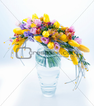 Fresh festive bouquet of flowers in glass vase