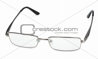 Reading glasses on white