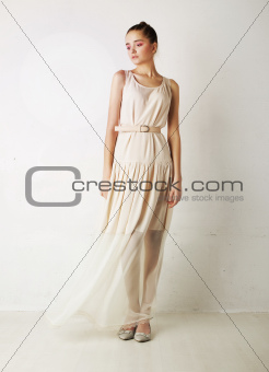 Stylish caucasian girl in white dress posing