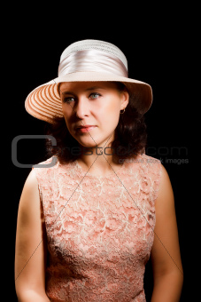An attractive woman in a hat