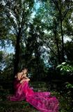 Fairy tale - fancy woman in dramatic pose, red dress