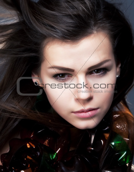 Closeup portrait of young woman beauty with waving hair