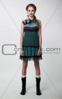 Fashion style - beautiful young girl posing in studio