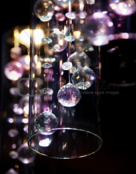 Abstract bright transparent glass balls on dark  background