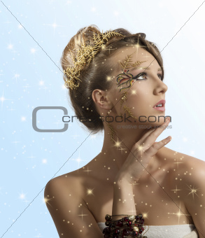 pretty girl with christmas decoration and hand over the chin