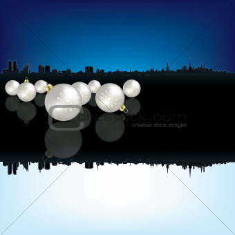 Christmas background with decorations and silhouette of city