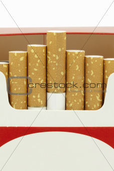 Cigarettes in opened cardboard box