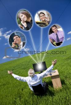 Businessman Computer Network In Green Field
