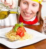 smiling chef garnish an Italian pasta dish